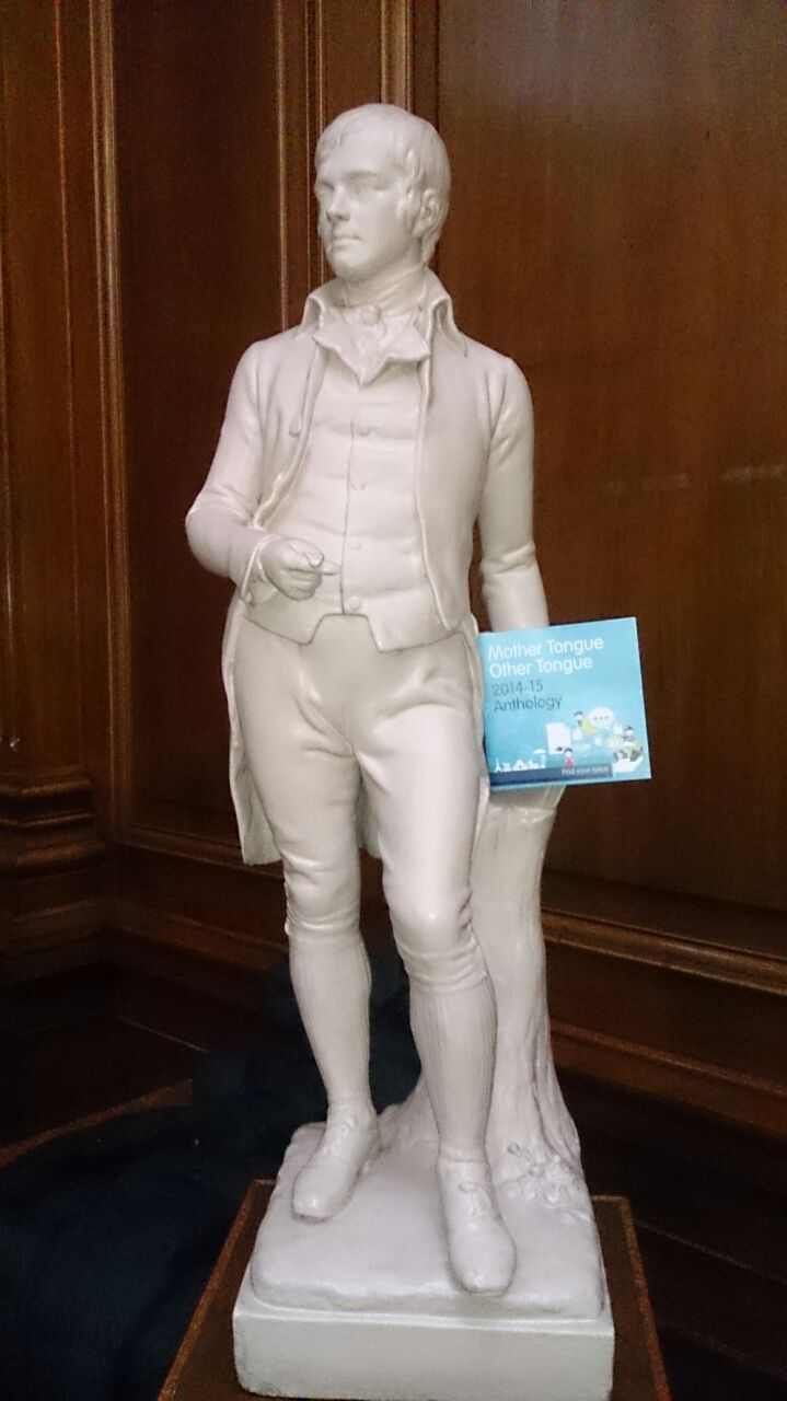 statue of Rabbie Burns holding MTOT anthology